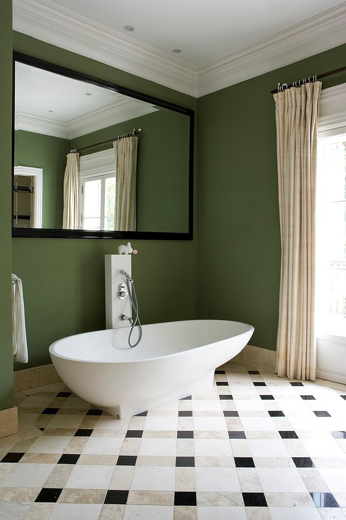 Green-backdrop-in-the-bathroom-lets-the-white-freestanding-bathtub-standout